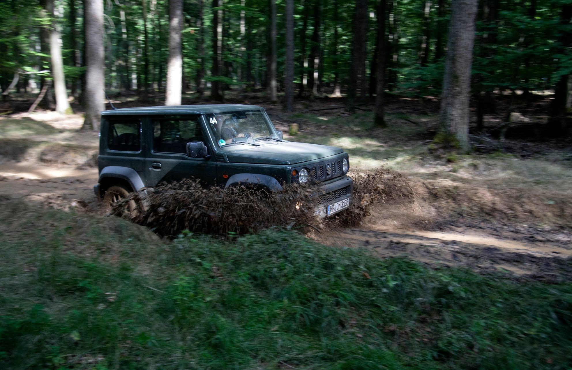 Suzuki Jimny through puddle